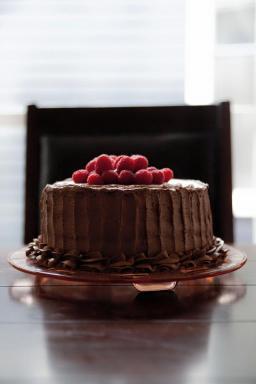 Chocolate cake with chocolate buttercream and fresh raspberries