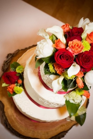 Three tiered cake with fresh floral topper and accents