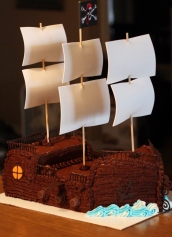 Pirate ship cake complete with cannons, sails and helm