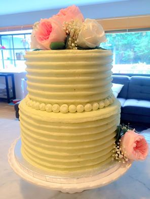 Two tiered buttercream cake with fresh flowers